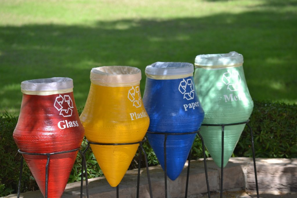 4 brightly coloured recycling bins giving people reasons to recycle