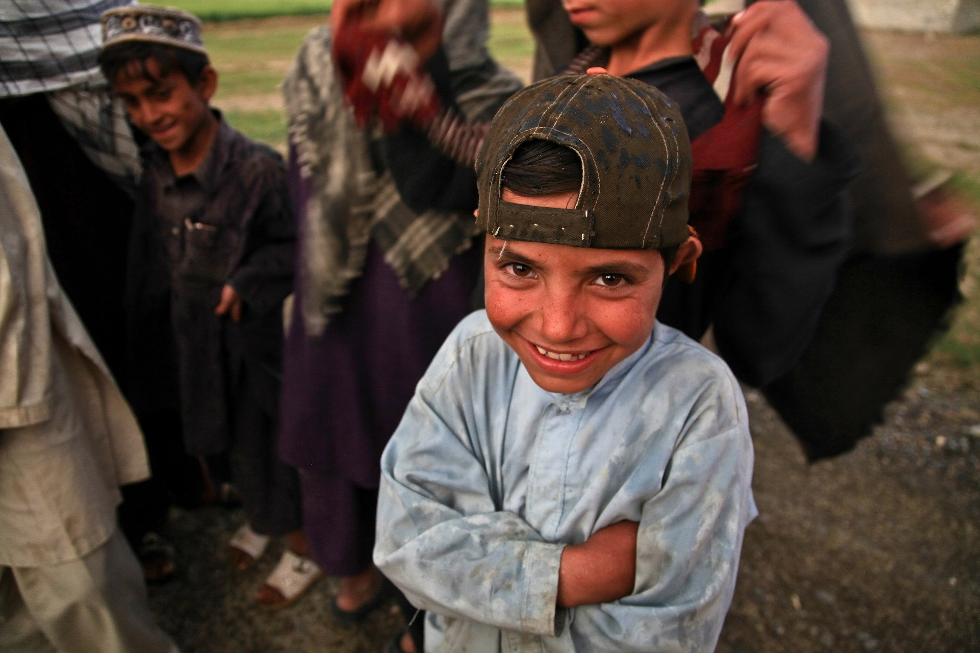 Impoverished young Afghani boy smiling