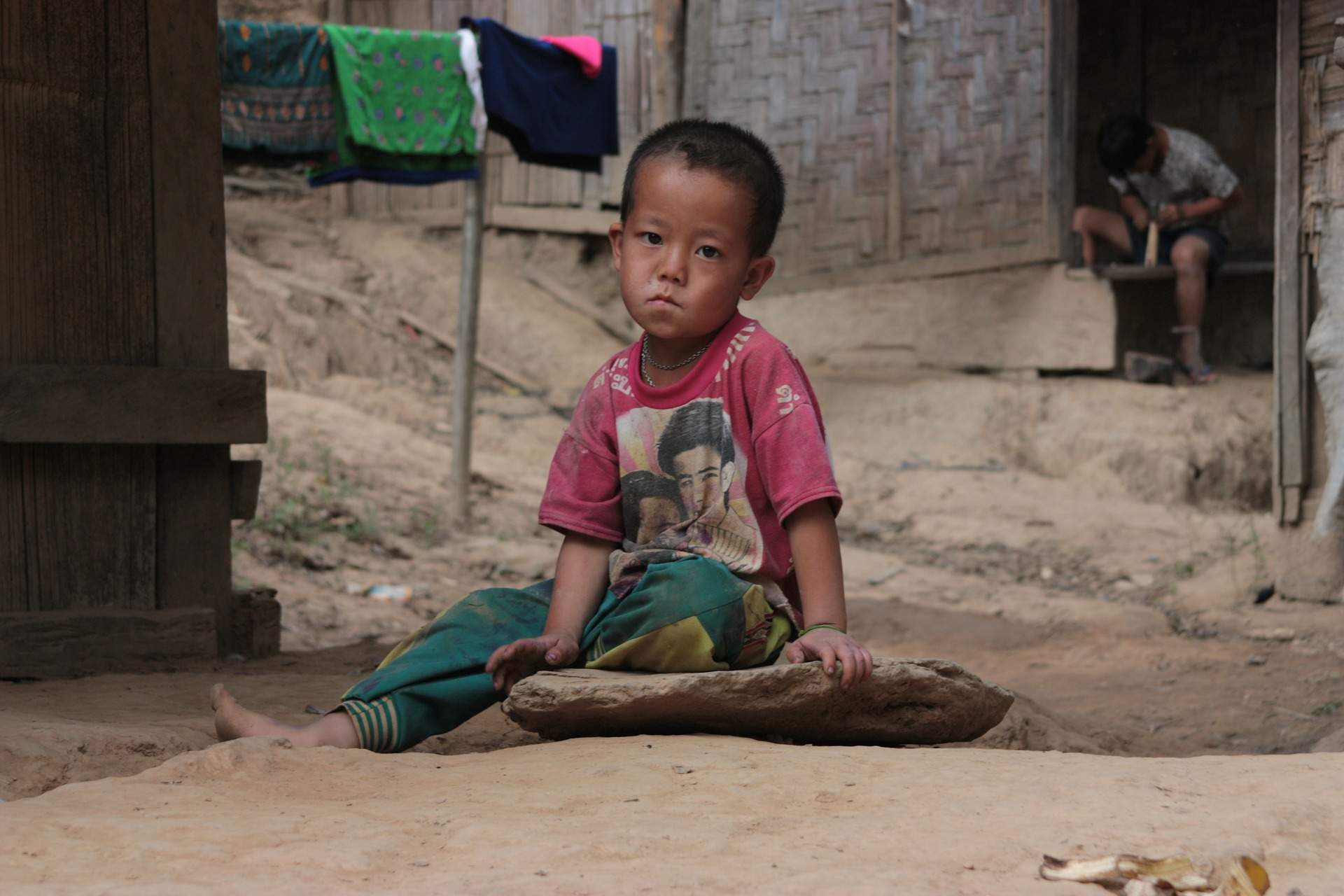 Young boy in poverty in developing region.