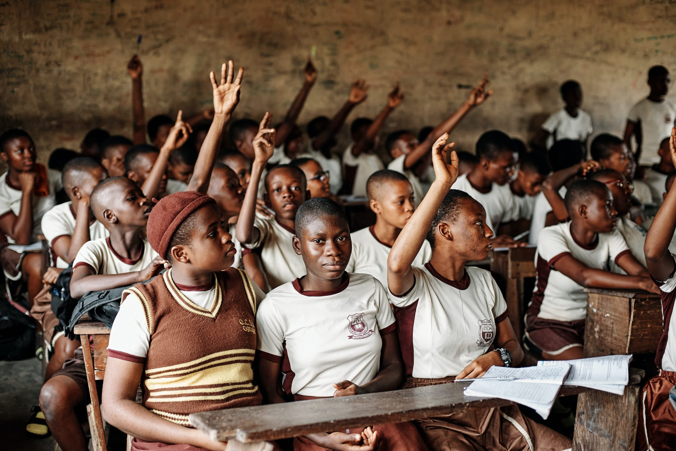 Picture of a classroom in a developing country, filled with students